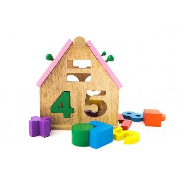 Drewniany dom sorter i cyfry